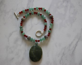 19 inch olive jade serpentine oval pendant necklace with 8mm aventurine, 4mm carnelian, 10mm silver plated beads gemstone beaded necklace