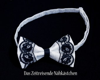 Stylish bow tie, white jaquard with lace trims, pre-tied