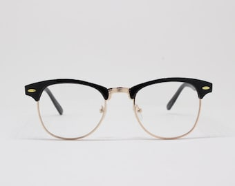 Clubmaster style glasses, black and gold browline half frame, classic 50s design spectacles. Prescription eyeglasses.