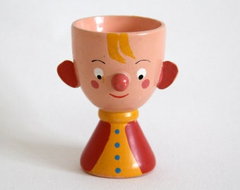 Vintage hand-painted wooden egg cup in cute boy character, possibly Sevi, 1960s