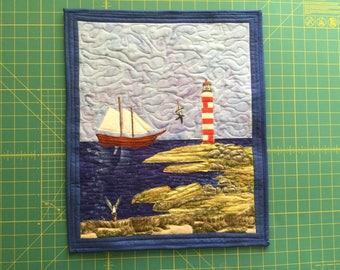 Lighthouse with schooner coastal scene
