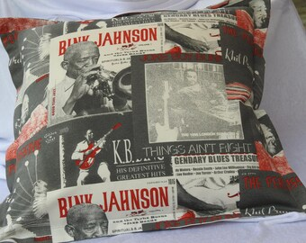 Cushion made with jazz images in shades of grey and red.