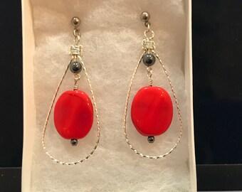 Dangling red earrings