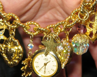 Vintage jewelry dangle Kirk's Folly gold tone watch charm bracelet Camelot of Time