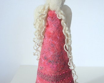 Hand felted pink wool angel embellished with yarns and beads.