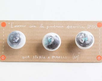 "Series of knobs, ""The man with the blue cheek"""
