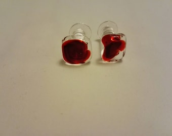 Glass cufflinks in clear and red glass