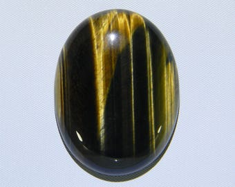 Natural Gold and Brown Oval Tigereye. A calibrated oval cabochon, 40x30x8mm. Golden chatoyancy is dominant in this cab!