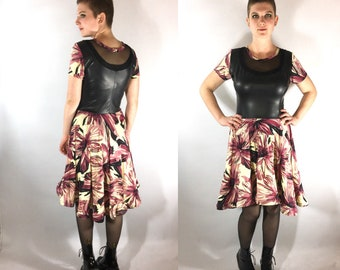 Faux leather and floral print dress with sheer cutouts