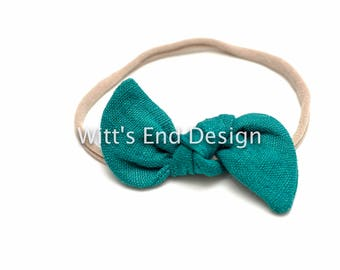 One Size Fits All- Top Knot Elastic Headband/Bow Collection-Emerald on nylon or metal clip