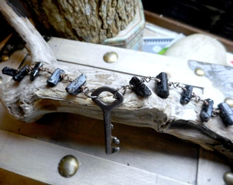 The Dark Room. Rough Black Tourmaline  Nuggets and vintage skeleton key bracelet