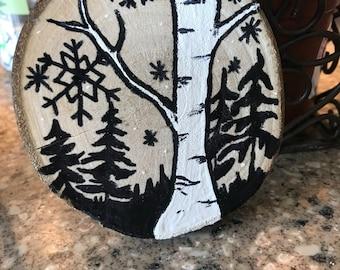 A snowy winter day wood slice