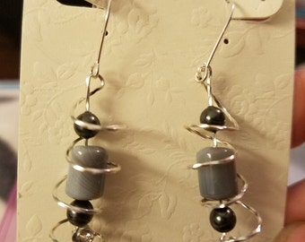 Silver wire wrapped earrings , spiral with gray and black beads