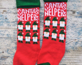 Pair of 1980s 1990s knit Christmas stockings Santa's Helpers red and green stockings with elves Christmas decor