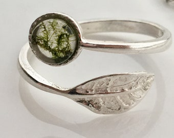 Sterling silver ring with moss captured inside resin stone