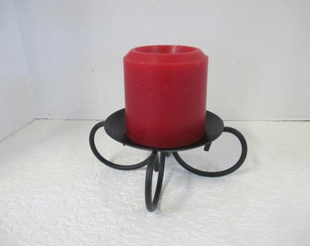 Vintage black wrought iron single tabletop spiked candle holder used.