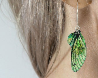 Leaf green fairy wing earrings. Green iridescent faerie wings on handmade sterling silver ear wires. Magical faery, fae jewellery