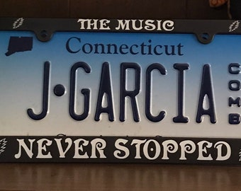 Grateful Dead License Plate Frame; The Music Never Stopped / Jerry Garcia / Dead & Company