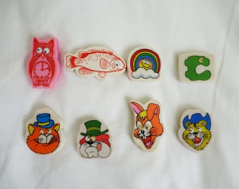 Six vintage novelty erasers
