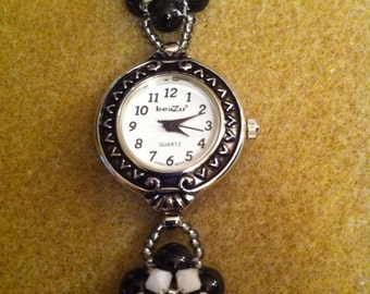 Genuine  swarovskicrystal and pearl watch. Measures 7 1/2 inches in length.