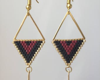 Earrings are made of black and Burgundy