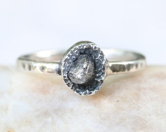 Gray tone rough diamond ring in bezel setting with hard texture oxidized sterling silver band
