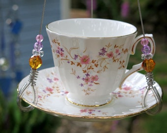 Teacup bird feeder crafted from recycled dinnerware