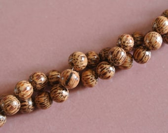 Set of 10 round coconut wood beads, 8 mm in diameter, pulling color light brown to dark brown spotted, hole: