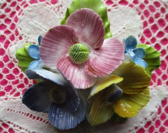 A vintage hand painted Thorley Bone China floral brooch in pristine condition