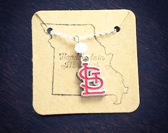 Red STL logo necklace with white bead