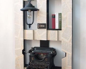 Bookshelf with WWI Olivetti typewriter + lamp + analog clock