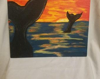 Whale swim sunset
