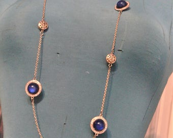 long chain necklace with blue glass stone and rhinestones