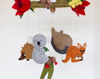 Australian animal baby mobile featuring kangaroo, koala, possum and echidna with Australian wildflowers and gumleaves
