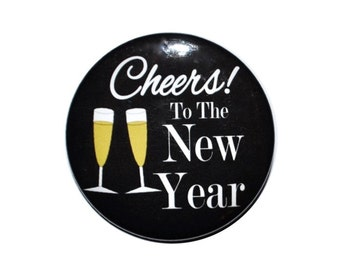 Happy New Years Eve Buttons Cheers to a new year Kiss me it's Midnight somewhere Kiss me it's New Year's Eve Party favors 2 1/4 inch button