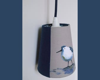 Light blue bird, dark blue textile cable
