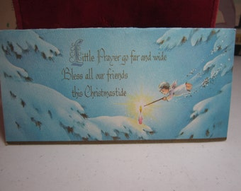 Colorful gold gilded 1950's mid century Sunshine christmas card cute angel lighting a pink candle on a snow covered tree