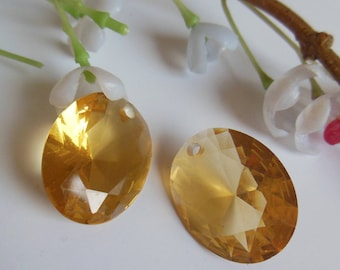 2 plastic oval pendants