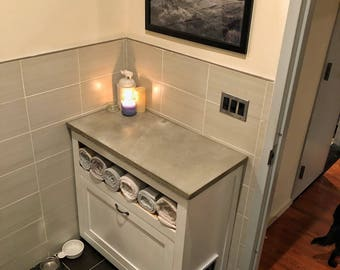 Litterbox hideaway bathroom cabinet with concrete top