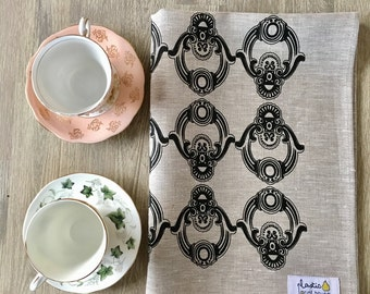 Black screen print on oatmeal linen tea towel