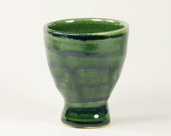 Green ceramic cup with striped decoration