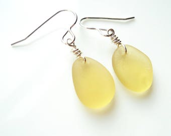 Seaham Sea Glass hook earrings of Soft Yellow drops suspended from Sterling Silver hooks - E1778 - from Seaham,  UK
