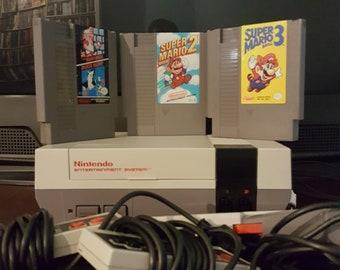 Nintendo NES Console - Super Mario Bros./Duck Hunt, Super Mario Bros. 2, Super Mario Bros. 3. 2 Controllers + Light Gun.