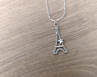 Silver necklace and eiffel tower