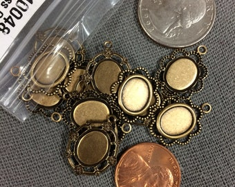 14 tiny bronze/brass bezels (2 designs)