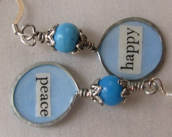 Happy Peace earrings with text encased in resin