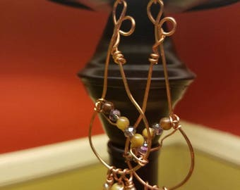 Bohemian styled copper earrings were made by the seller.
