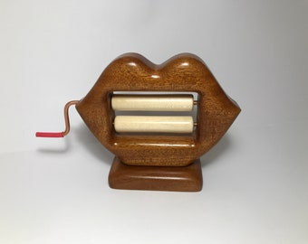 "Hand Carved Wooden Figurine ""Lip-Perforating Machine"""
