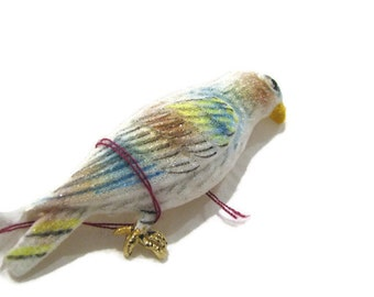 White and jewel tone tropical bird brooch. Sandy texture. Very interesting pin.