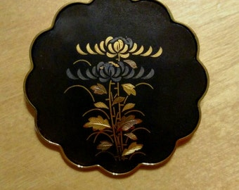 Vintage Amita Japanese gold and black pin brooch with chrysanthemum design and scalloped edges.